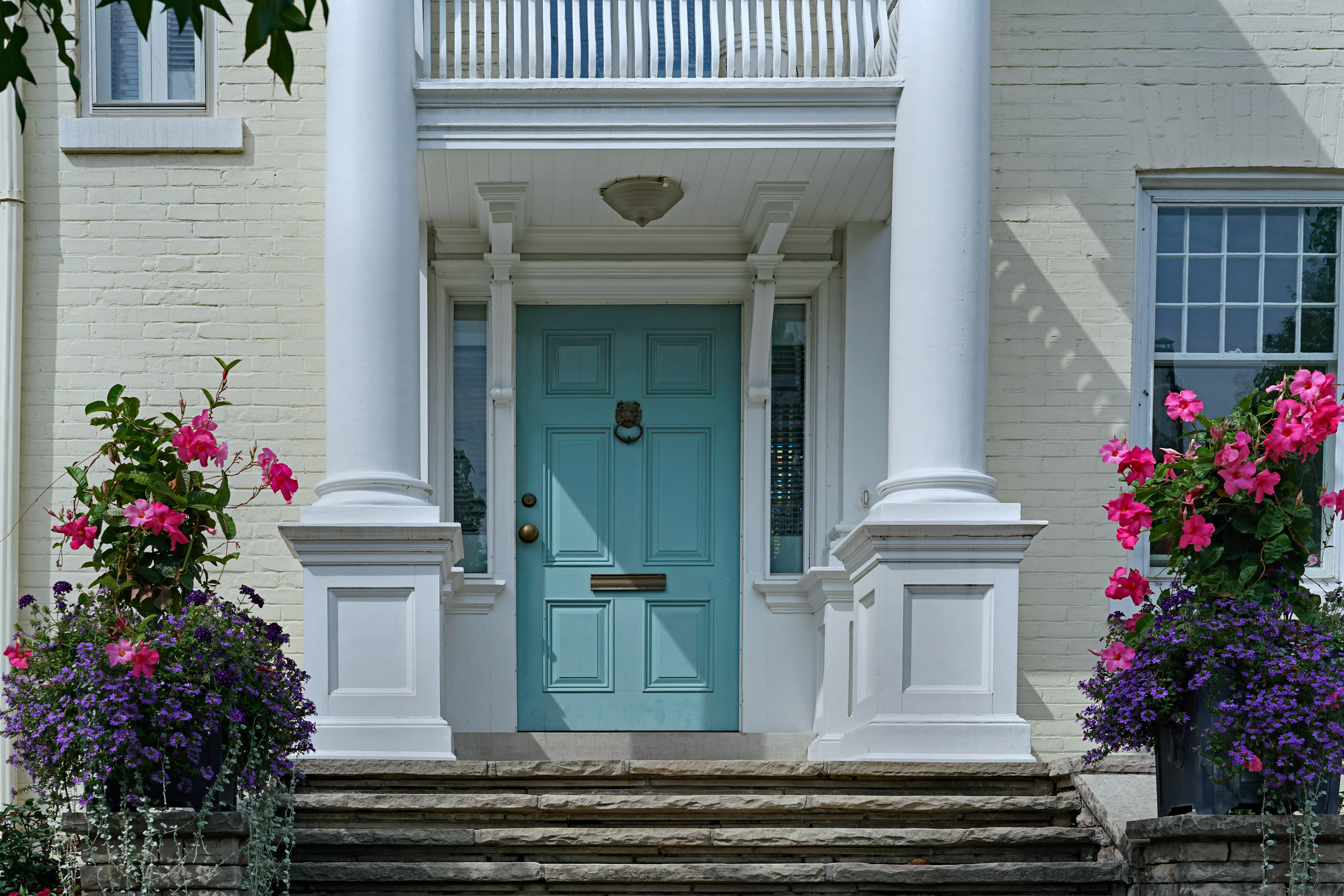 Elegant front door with white pillars