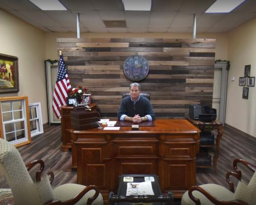 Allen Cheek Sitting at Desk